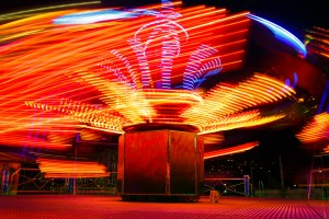 Evening picture carousel in an amusement park at autumn time